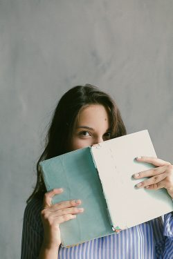 A woman reading book to learn Polish